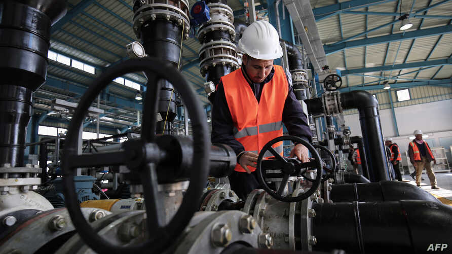 A Palestinian employee works at a desalination plant during the inauguration of the first phase of the project on Jan. 19, 2017, in Deir el-Balah in central Gaza.