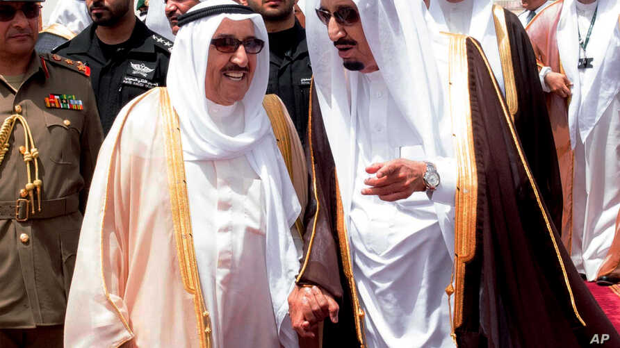 File - King Salman of Saudi Arabia (R) welcomes Kuwaiti Emir Sabah Al Ahmed Al Sabah upon his arrival to Riyadh Airbase before the opening of Gulf Cooperation Council summit in Riyadh, Saudi Arabia, May 2015.