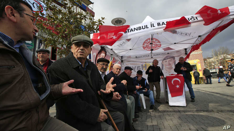 In this March 15, 2017 photo, supporters of Turkey's main opposition Republican People's Party, or CHP, sit at their tent promoting the 'NO' vote for the upcoming referendum, in central Istanbul.