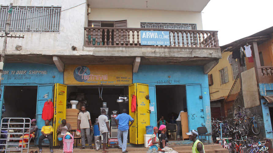 In this July 15, 2014 photo,  the Arwa clinic, center,  that was closed after the clinic Doctor got infected by the Ebola virus in the capital city of Freetown, Sierra Leone.
