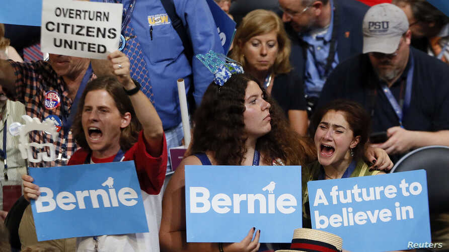 Supporters of Senator Bernie Sanders (D-VT) react as they listen to him speak during the Democratic National Convention in Philadelphia, Pennsylvania, U.S. July 25, 2016.
