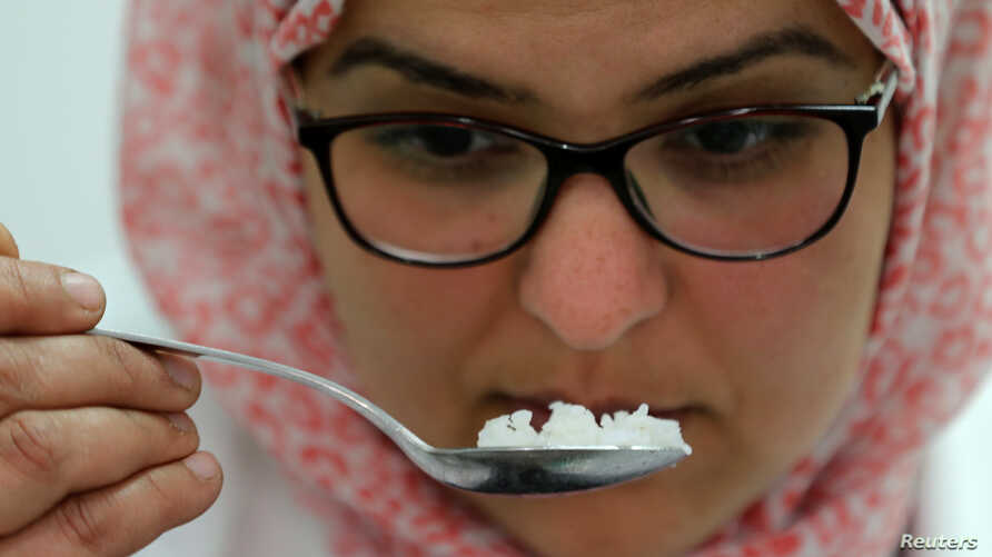 A food scientist tastes samples of rice to make sure they fit Egyptian standards, in a research center affiliated with Egypt's agriculture ministry in Cairo, Egypt, March 25, 2019.