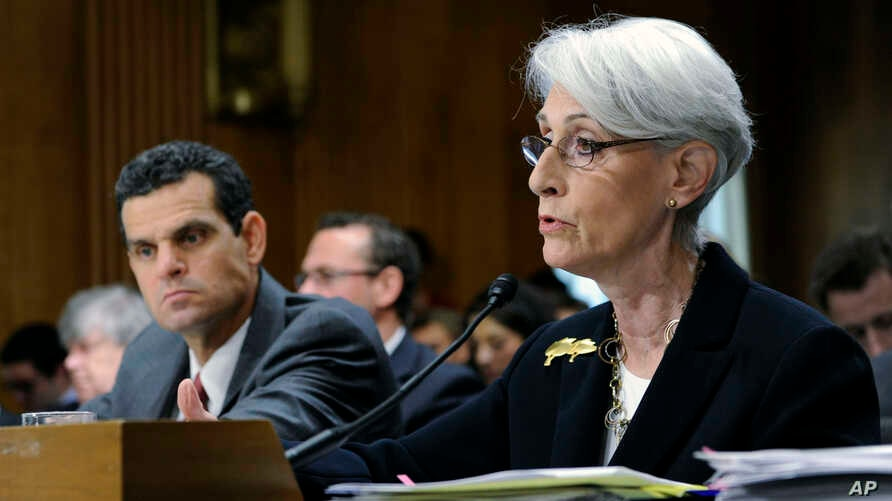 Undersecretary of State for Political Affairs Wendy Sherman (R) accompanied by Treasury Undersecretary For Terrorism And Financial Intelligence David Cohen, testifies on Capitol Hill in Washington, July 29, 2014.