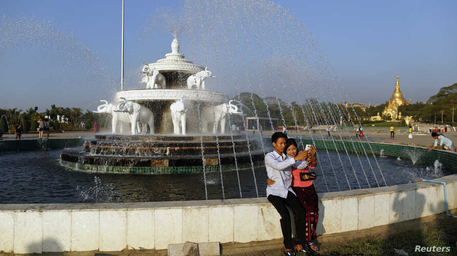 A couple takes a self-portrait at People's Square on Valentine's Day near Shwedagon pagoda in Rangoon, Feb. 14 , 2014.