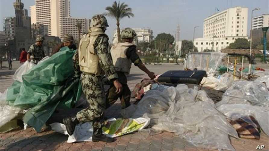 Egyptian Army soldiers remove tents of protesters from Tahrir Square in Cairo, Egypt, Sunday, Feb. 13, 2011. Egypt's military has started taking down the makeshift tents of protesters who camped out on Tahrir Square in an effort to allow traffic and