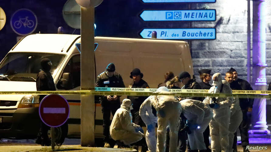 Investigators work on the street during a police operation during which the suspected gunman, Cherif Chekatt, who killed three people at a Christmas market in Strasbourg, was killed, in the Meinau district in Strasbourg, France, Dec. 13, 2018.