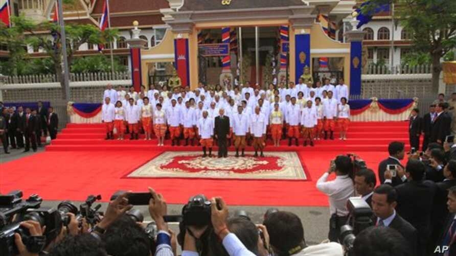 Cambodia's King Norodom Sihamoni, front row second left, stands together with Prime Minister Hun Sen, second from right, and National Assembly President Heng Samrin, left, Minister of Royal Palace Kong Samol, right, and the nation's lawmakers during