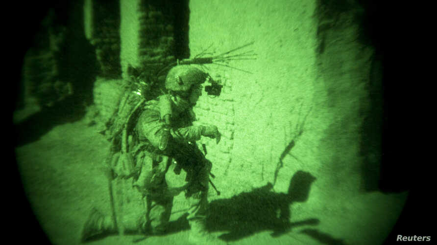 A coalition soldier in Afghanistan is seen through a night vision device (file photo).