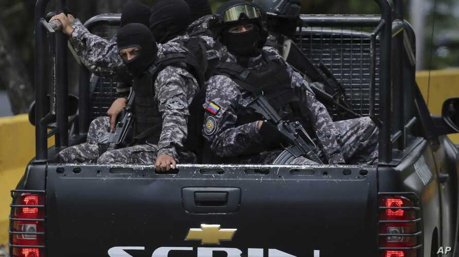 Members of the Venezuelan Bolivarian Intelligence Service arrive to the Junquito highway during an operation to capture Oscar Perez in Caracas, Venezuela, Jan. 15, 2018.