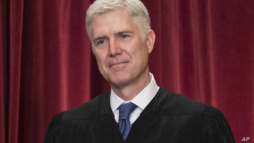 Associate Justice Neil Gorsuch joins other justices of the U.S. Supreme Court for an official group portrait at the Supreme Court Building in Washington. June 1, 2017.