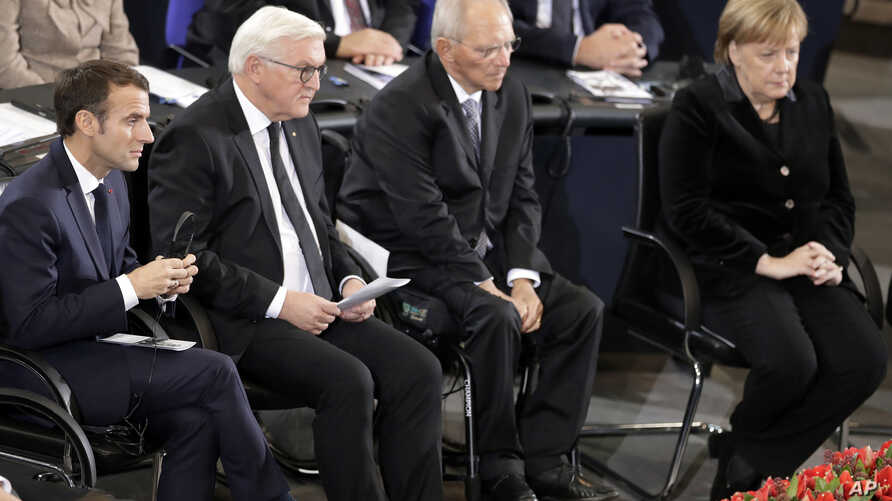 France's President Macron, German President Steinmeier, Wolfgang Schaeuble, President of the German Federal Parliament, and German Chancellor Merkel attend a meeting of the Bundestag in Berlin, Nov. 18, 2018,  Germany's national day of mourning.