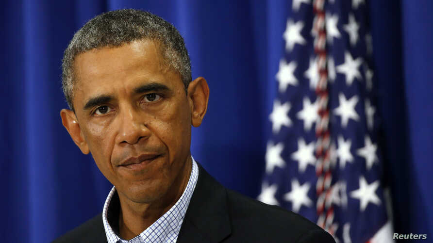 U.S. President Barack Obama speaks about Iraq and also the shooting in Ferguson, Missouri from his vacation on Martha's Vineyard, Massachusetts, Aug. 14, 2014.