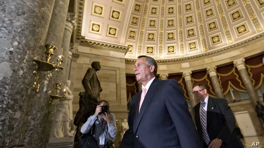 Speaker of the House John Boehner, R-Ohio, walks to the House floor for a vote on the continuing resolution, at the Capitol in Washington, Monday night, Sept. 30, 2013.