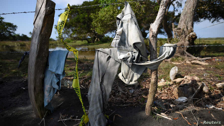 Clothing is pictured on a wire fence at site of unmarked graves where a forensic team and judicial authorities are working in after human skulls were found, in Alvarado, in Veracruz state, Mexico, March 19, 2017.