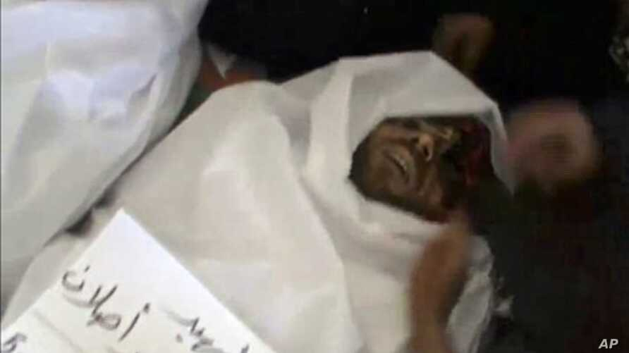 Image from amateur video purports to show body of man killed by Syrian regime forces in Idlib, June 5, 2012.