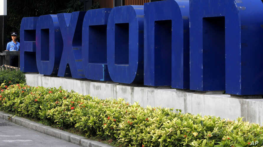 A security guard stands at the entrance of the Foxconn complex in the southern Chinese city of Shenzhen, Southern city in China.