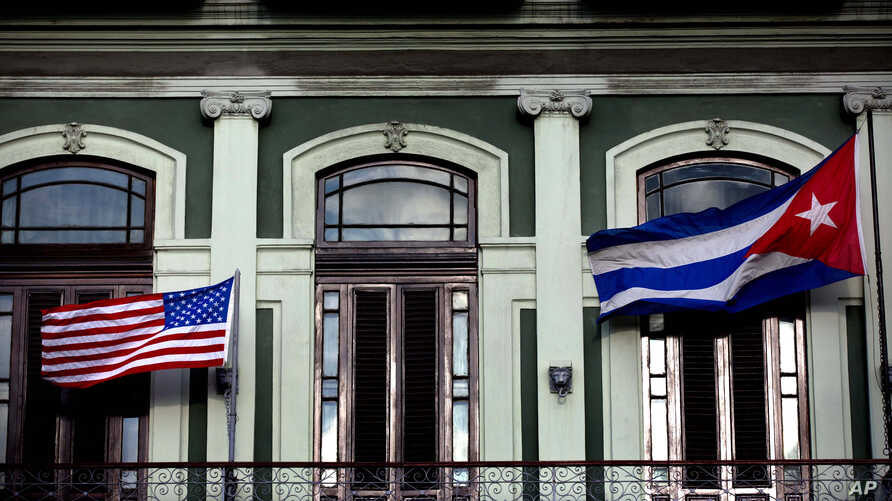 A Jan. 19, 2015 photo shows the Cuban and US flags waving from the balcony of the Hotel Saratoga in Havana.