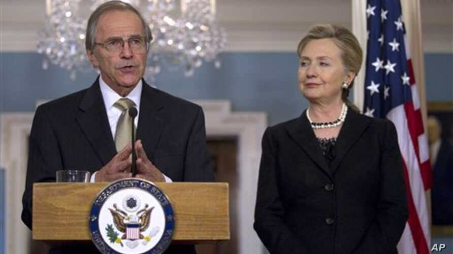 Secretary of State Hillary Rodham Clinton listens to Ambassador Princeton Lyman, during the announcement of his appointment as the new U.S. Special Envoy for Sudan, March 31, 2011, at the State Department in Washington.