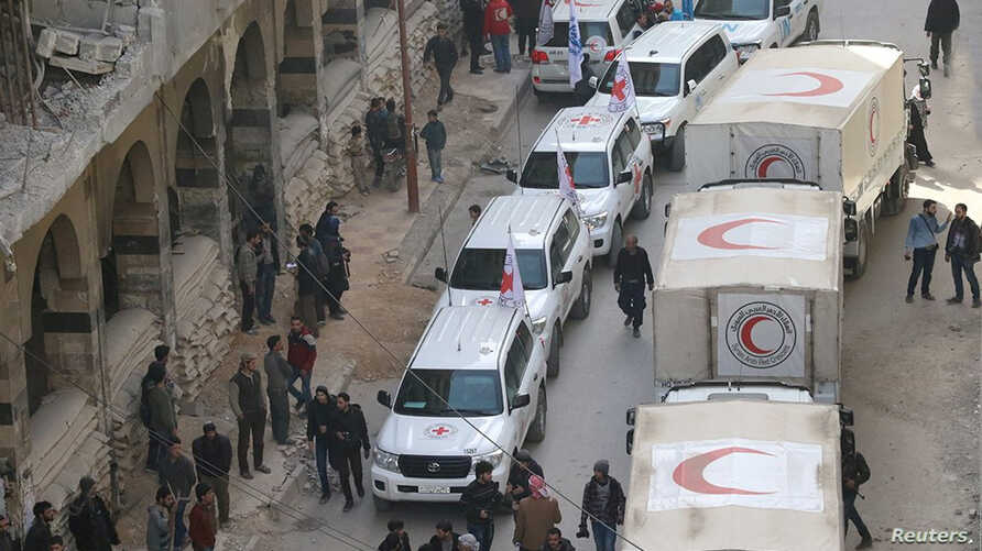 Trucks from Syrian Red Crescent and humanitarian partners are seen in Ghouta, Syria, March 5, 2018, in this picture obtained from social media.
