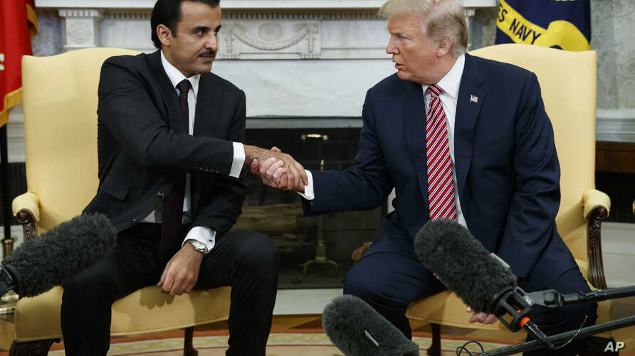 President Donald Trump shakes hands with Emir of Qatar Sheikh Tamim bin Hamad al-Thani in the Oval Office of the White House, April 10, 2018, in Washington.