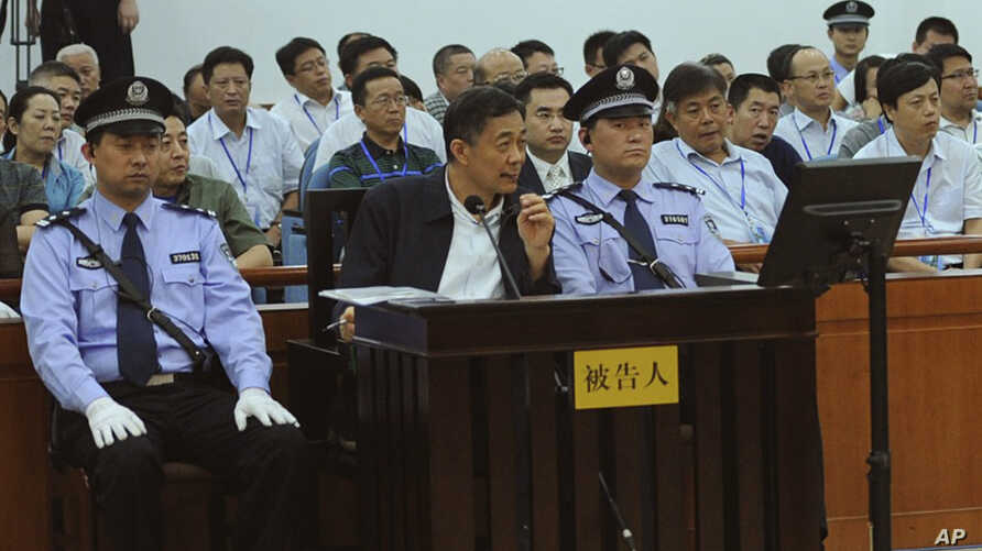 In this photo released by the Jinan Intermediate People's Court, former Politburo member and party leader of the megacity of Chongqing Bo Xilai, in the defendant seat listens to a testimony by former Chongqing city police chief Wang Lijun, unseen, at