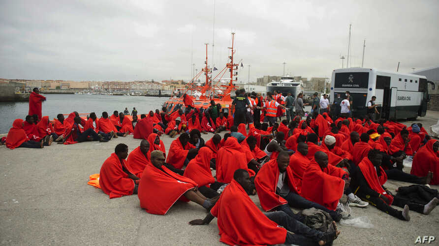 Would-be immigrants rest at Tarifa's harbour on August 11, 2014 after being rescued off the Spanish Coast. Spain's coastguard today rescued more than 200 sub-Saharan African migrants crossing the Strait of Gibraltar on small boats.