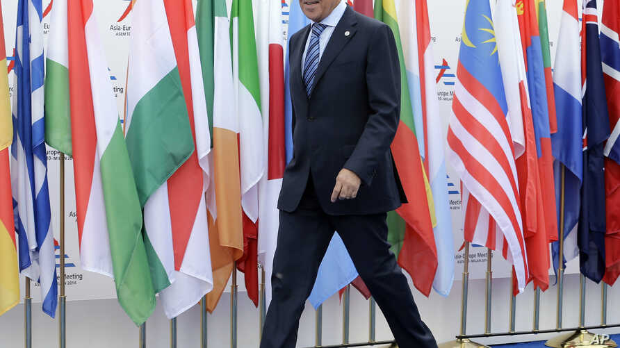 German Chancellor Angela Merkel arrives at a Milan's hotel, Italy, Thursday, Oct. 16, 2014. Russian President Vladimir Putin is mounting a diplomatic blitz on the sidelines of a summit of European and Asian leaders in a bid to escape Russia's worst c...
