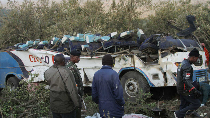 A crashed bus lies with it's roof completely destroyed in Narok, Kenya, Aug. 29, 2013.