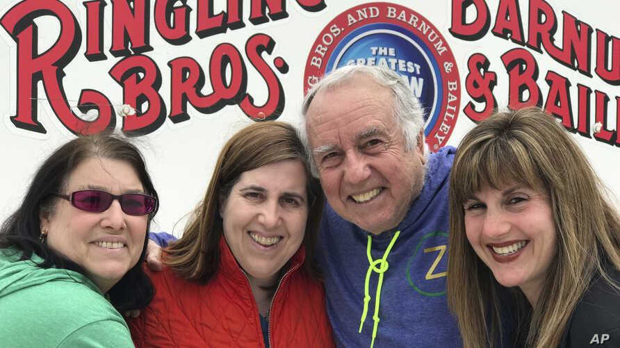 Gene Goldstein (center right) and his family stop for a photo outside the Nassau Veteran's Memorial Coliseum in Uniondale, N.Y., which is hosting the final performances of the Ringling Brothers and Barnum & Bailey Circus, May 20, 2017. From left are