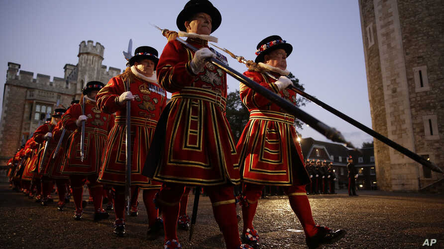 FILE - Yeoman Warders of the Tower of London, nicknamed Beefeaters, arrive to take part in a ceremony to install General Sir Nicholas Houghton as the 160th Constable of the Tower of London in London, Oct. 5, 2016.