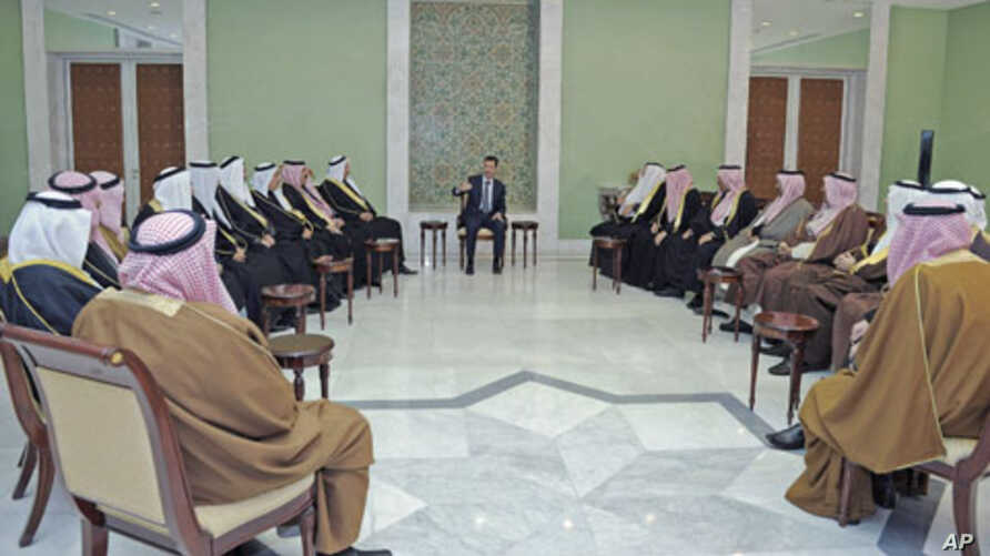 Syria's President Bashar al-Assad (C) meets a delegation of clan leaders from three cities in nation's northeastern region - Deir Ezzour, Raqqa and Hasaka - in Damascus, Syria, December 22, 2011.