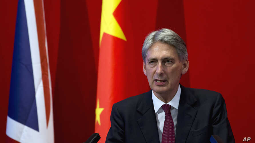 British Foreign Secretary Philip Hammond delivers his speech at Peking University in Beijing, Aug. 12, 2015.