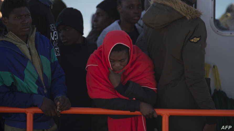 Migrants wait aboard a Spanish coast guard boat upon their arrival at Malaga's harbor on Dec. 10, 2018, after an inflatable boat carrying 118 migrants was rescued by the Spanish coast guard off the Spanish coast.