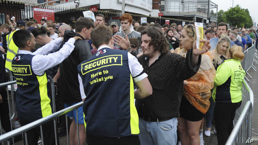 Fans are searched as they arrive for a concert at Old Trafford cricket ground in Manchester, England, May 27 2017. More than 20 people were killed in an explosion following a Ariana Grande concert at the Manchester Arena late Monday evening.