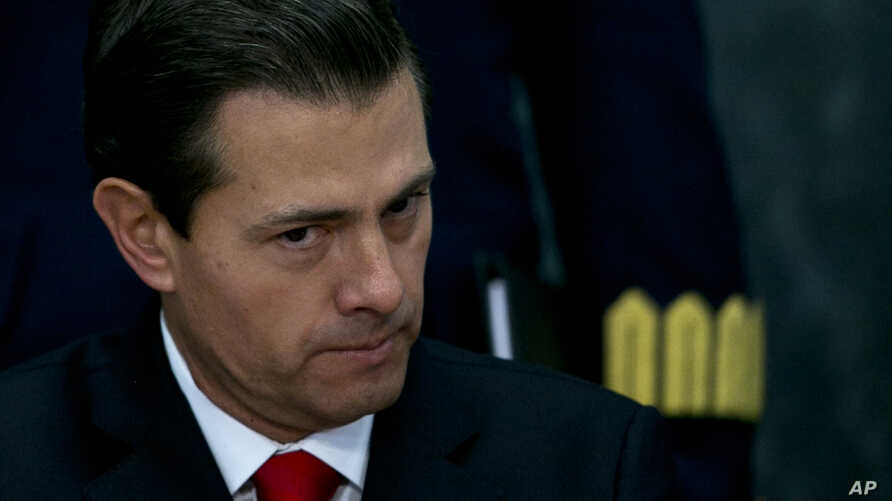 FILE -  Mexico's President Enrique Pena Nieto makes a pause during a press conference at the Los Pinos presidential residence in Mexico City, Jan. 23, 2017.