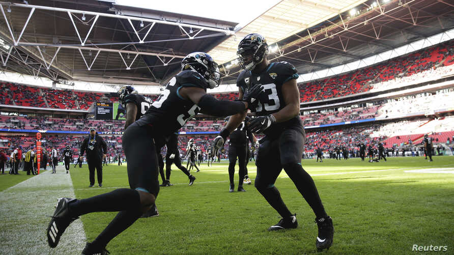 Players for the Jacksonville Jaguars prepare for  an NFL  game against Philadelphia Eagles at Wembley stadium in London, Oct. 28, 2018.