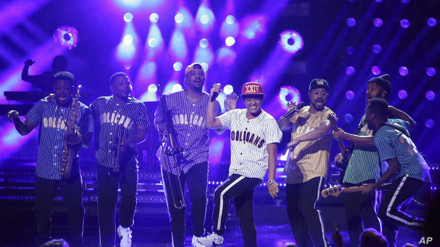 """FILE - Bruno Mars performs """"Perm"""" at the BET Awards at the Microsoft Theater on Sunday, June 25, 2017, in Los Angeles."""