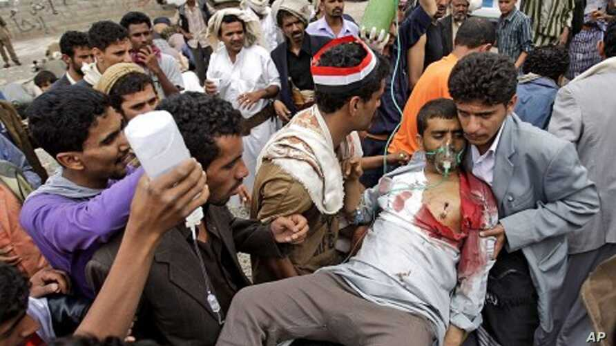 An injured tribesman loyal to Sheik Sadeq al-Ahmar, the head of the powerful Hashid tribe, is brought to a field hospital after being wounded in clashes with Yemeni security forces, in Sana'a, Yemen, June 1, 2011
