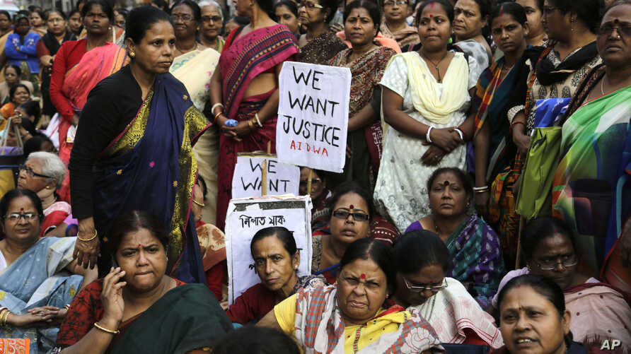 FILE - Women activists participate in a demonstration demanding highest punishment for convicted persons in the Kamduni rape case and the re-arrest of two acquitted persons near the city court in Kolkata, India, Jan. 29, 2016.