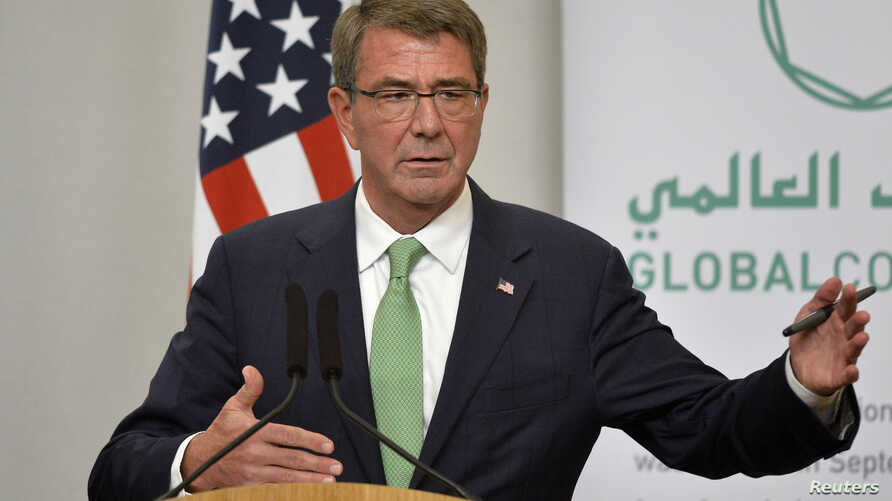 U.S. Secretary of Defense Ash Carter attends a press conference with Britain's Defense Secretary Michael Fallon at the Foreign Office in London, Dec. 15, 2016.