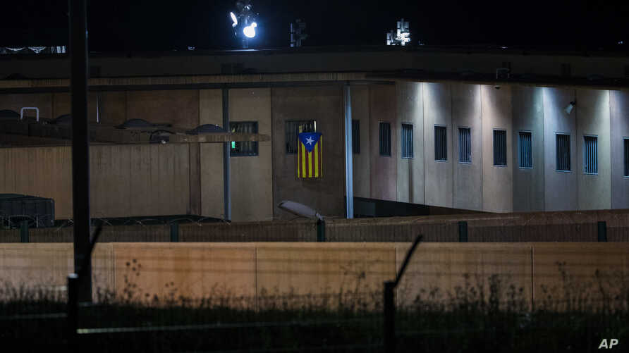 "An ""estelada"" or independence flag is waved from the window of a cell in Lledoners prison, in Sant Joan de Vilatorrada, about 50 kilometers away from Barcelona, Spain, Sept. 18, 2018."