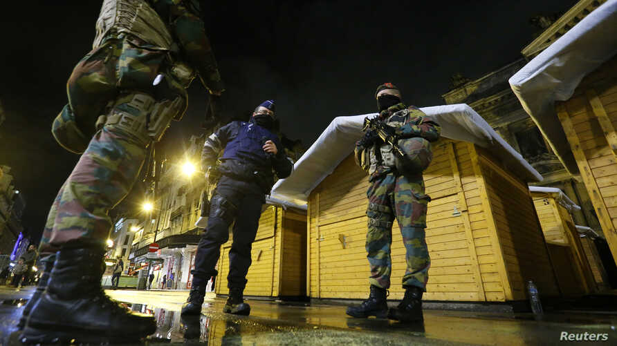 """Belgian soldiers patrol in central Brussels after the alert status was raised to its highest level because of a """"serious and imminent"""" threat of a terrorist attack, Nov. 21, 2015."""