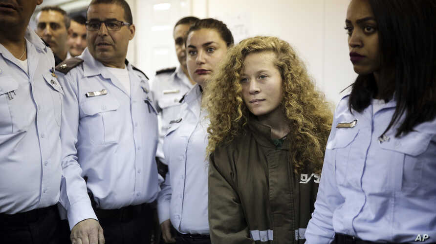 Ahed Tamimi, a blonde 17-year-old from the West Bank village of Nebi Saleh, is brought to a courtroom inside Ofer military prison near Jerusalem, Dec. 28, 2017.