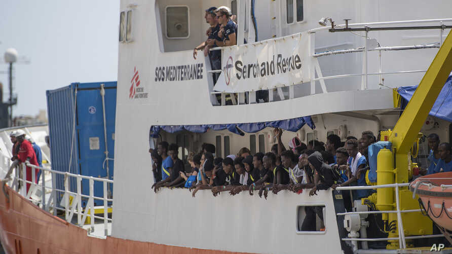 FILE - In a Aug. 15, 2018 file photo, the Aquarius rescue ship enters the harbor of Senglea, Malta. Spain's maritime rescue service said Sunday, Sept. 23, 2018 that it rescued more than 400 people from 15 small boats, most of them off the country's s