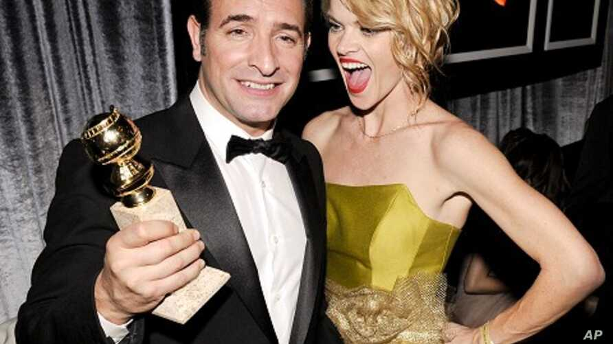 "French actor and winner of the Golden Globe for Best Performance by an Actor in a Motion Picture - Comedy or Musical for his role in ""The Artist"" Jean Dujardin and cast member Missi Pyle (R) attend The Weinstein Company after party after the 69th ann"