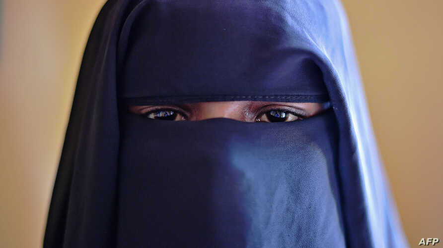 Fatima (not her real name), 14, poses at the Elman Centre in Mogadishu,  March 24, 2015. After Fatima was raped by a tuk-tuk driver, she was arrested, detained for a month and raped repeatedly by a police officer, she and her aunt said. In a country