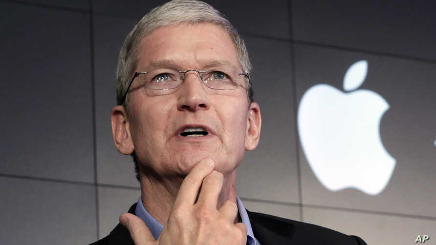 FILE - Apple CEO Tim Cook responds to a question during a news conference at IBM Watson headquarters, in New York.