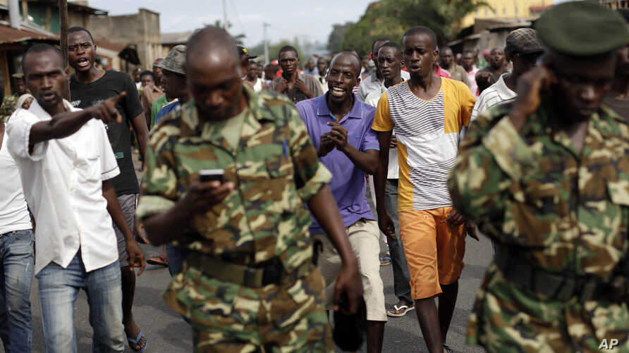 Protesters opposed to President Pierre Nkurunziza's decision to seek a third term in office shout at the army after a demonstrator was shot dead in the Kinama district of Bujumbura, Burundi, May 7, 2015.
