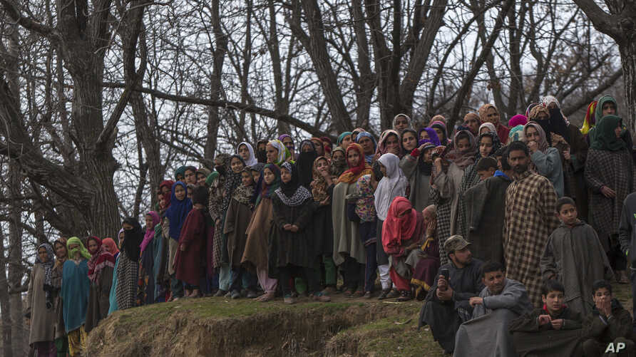 FILE - Kashmiri villagers watch the funeral of a civilian killed in a grenade blast, in Goosu, about 40 Kilometers (25 miles) south of Srinagar, Indian controlled Kashmir, March 3, 2017.