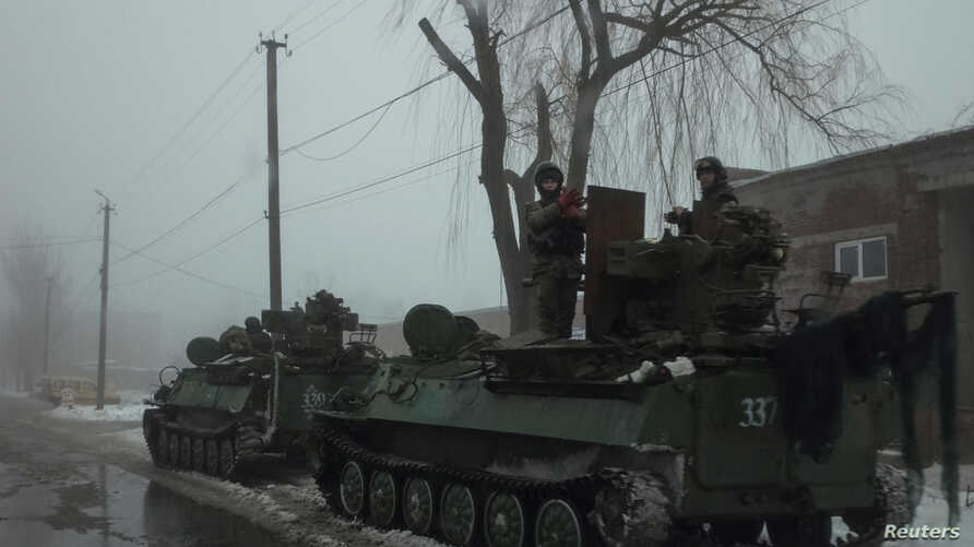 Members of the Ukrainian armed forces ride armored personnel carriers near the government-held industrial town of Avdiivka, Ukraine, Feb. 4, 2017.
